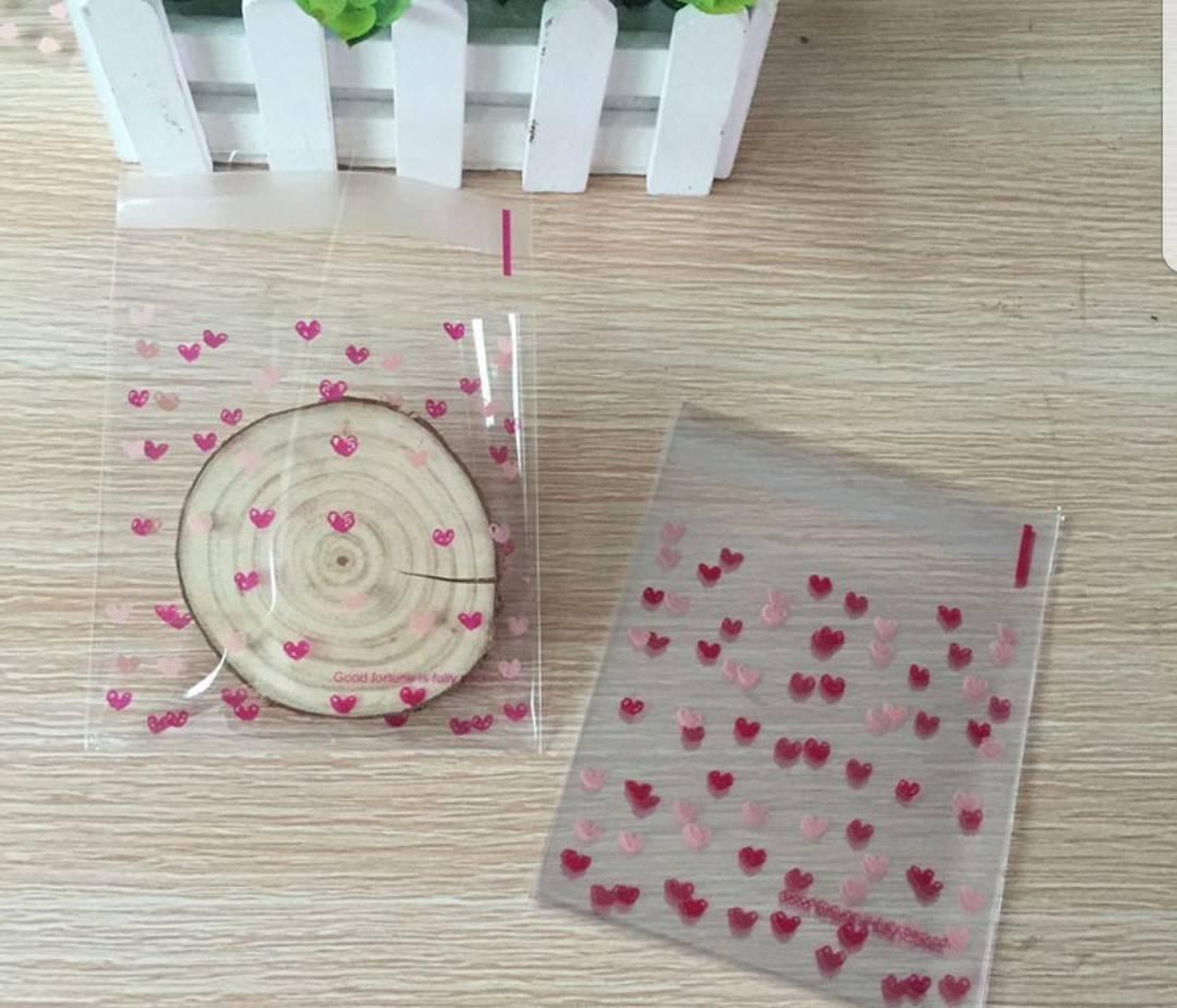 ถุงเบเกอรี่ ถุงขนมปัง แบบมีเทปกาว รูปหัวใจ 100 ใบ/ห่อ (10*10+3 cm.)