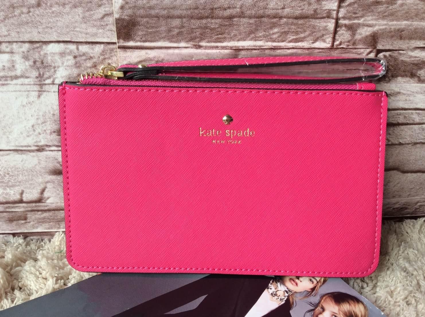 Kate Spade purse wristlet กระเป๋าถือ คล้องแขน ขนาดเล็กใส่เงิน ใส่โทรศัพท์ได้ ใส่ของจุกจิก น่ารักมากๆ Color : ชมพู Size : กว้าง 20 x สูง 12 cm.