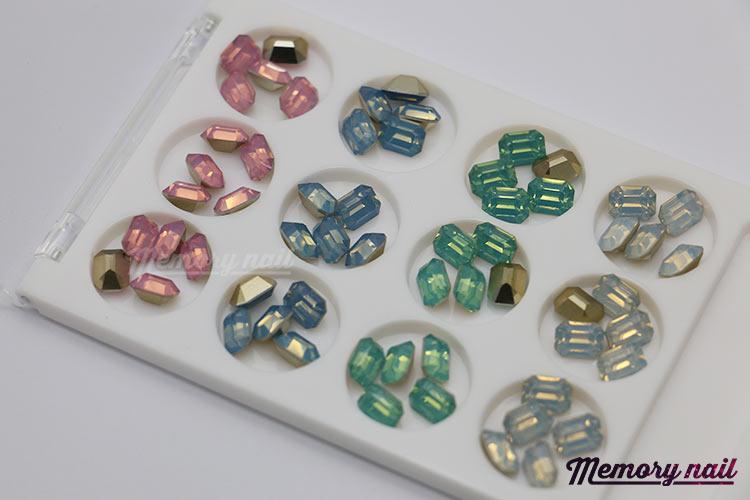 เพชรทรงสีเหลี่ยมตัดขอบ ตูดแหลมมล ขนาด 8 มิล คละ4สี กล่องเหลี่ยมขาว